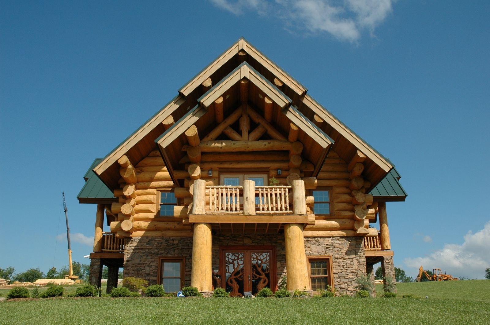 Modern log cabins plans hearthstone homes for Contemporary log home designs