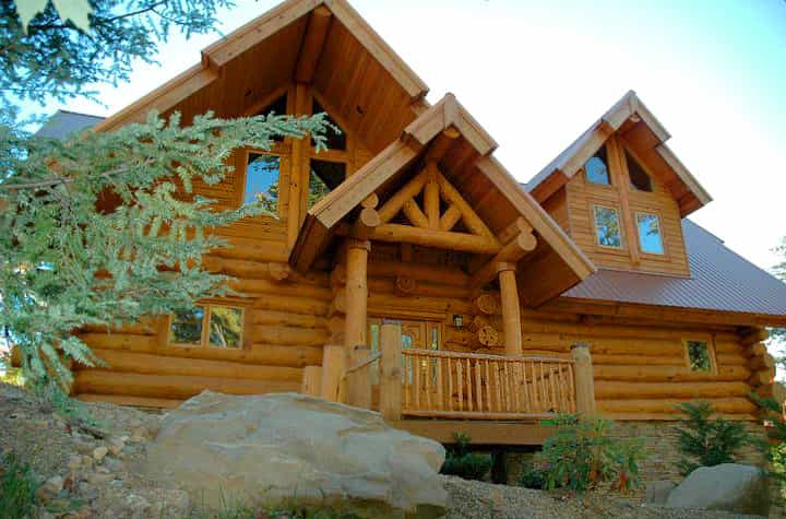 Modern log cabin designs hearthstone homes for Ranch style timber frame homes