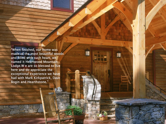Timber frame homes by hearthstone homes for Hewn log cabin kits