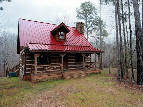 Hand hewn log homes cabins hearthstone homes for Steel frame cabin