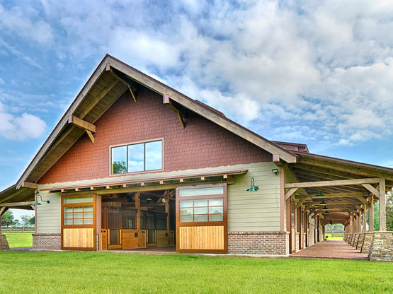 Timber frame horse barn plans designs by hearthstone homes for Barn frame homes