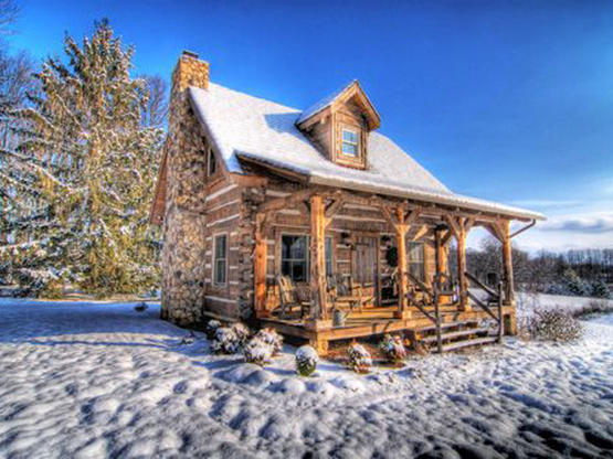 Log homes log cabin homes timber frame homes hand hewn for Hewn log cabin kits