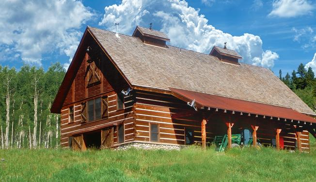 Traditional log barns pay homage to a great american tradition for Great american log homes